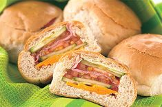 Fill dinner rolls with layers of sandwich ingredients. When they are cut in half, they look like striped sandwiches. Good for picnics or casual parties.