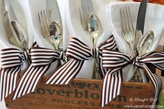 A simple way to dress up your table is by wrapping linen napkins with ribbons and placing in a vintage cheese box. A little glam meets rustic!