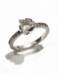 Todd Pownell: Uncut Diamond Ring, Ring in 950 palladium with 1.21CT uncut triangular diamond set on a 2x2mm shank set with full cut bead set diamonds. Size 6 (Design may be special ordered to size. Price will vary.)