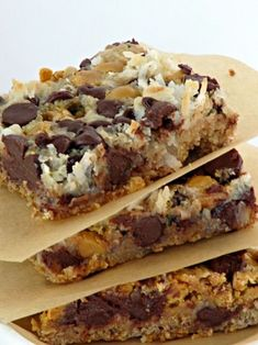 MAGIC BARS 1/2 cup melted butter 11/2 cups of graham cracker crumbs 1 can of Eagle brand condensed milk 2 cups if chocolate chips 1 cup of butter scotch chips 11/2 cups of coconut by Raelynn8