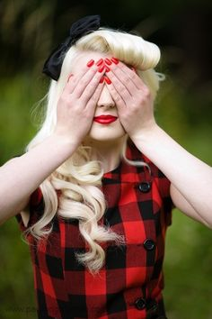 I love everything about this! Her hair, plaid, red nails, and the bow. Adorable
