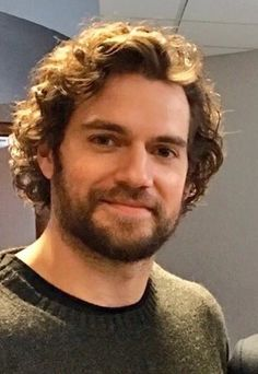 """""""New photo of Henry Cavill. RT if you like the long, curly hair. LIKE if you prefer shorter hair. #HenryCavill #Nomis"""""""