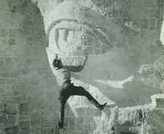 Mount Rushmore, hanging in the sky, working on an eye. Not a single man or woman died during the 14 years of blasting and carving to create the Mount Rushmore National Memorial. Photo #29 by Charles D'Emery / NPS