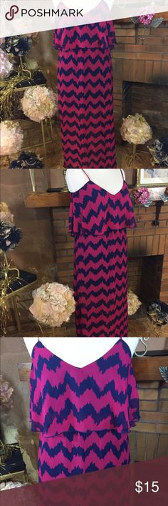 Ultra Flirt maxi dress sz L Ultra Flirt magenta and navy dress with chevron pattern. Size Juniors large. Lined in top half sheer from knee down. Slit in the side up to calf. 36in bust and 34in waist with some room for stretch. Has adjustable spaghetti straps. Minimally previously worn condition. Please check out all pictures. Read full description of the items. To ensure a happy shopping experience, please ask me any questions. Thanks for looking and happy shopping. Ultra Flirt Dresses Maxi