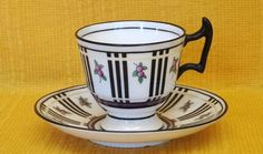 Doulton deco: unnamed footed demitasse / coffee cup duo by Robert Allen, E9698, RA8265, c1918 (impressed 8-18). Yellow bands intersect black stripes and berry motifs, with black highlights and trim.