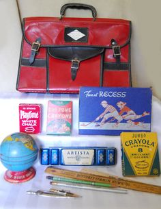 Vintage school supplies and a book satchel.