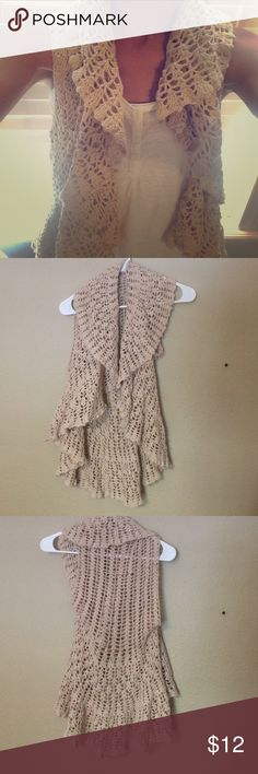 ✨HP✨ Knit cardigan This cardigan is a beige color and is sleeveless. It also drapes over in the front. The tag is missing on the back so I can't see what size it is, but I wear a S/M and it fits perfectly. Sweaters Cardigans