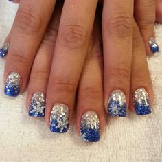Blue and silver glitter gel nails with konad stamp snowflakes