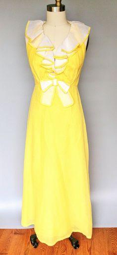 db382cc8aa Banana phone 1970s canary yellow halter maxi dress by miss