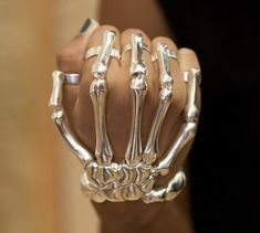 Skeleton Hand Bracelet - The skeleton ring and bracelet combo designed by Delfina Delettrez is available in silver or gold. Whatever the metal, it will make an impression on everyone who sees it (or leave one if you punch someone with it)