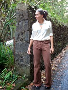 white button down tucked into brown pants