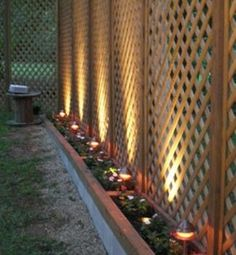 GREAT idea for a privacy fence that's easier on the pocketbook. Lattice to the height you want and the solar lights gives it the finished look. Latice Fence, Lattice Privacy Fence, Lattice Screen, Privacy Screen Outdoor, Privacy Planter, Lattice Patio, Cheap Privacy Fence, Privacy Trellis, Outdoor Fencing