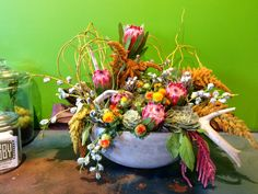 Fall flower arrangement. King protea, succulents, antlers. Flowered by Travis Payne #fall #fallarrangement #succulents #antlers # protea