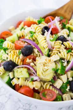 This vegan Greek pasta salad is perfect for your next BBQ or potluck! It's one of my favorite pasta salad recipes! Or actually one of my favorite summer recipes! Find more vegan recipes at veganheaven.org!