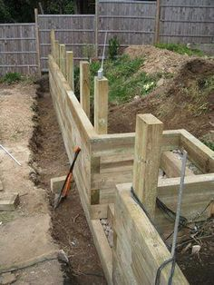 DIY Front Yard Retaining Wall Ideas - Enjoy Your Time - This tutorial was created for ., DIY Front Yard Retaining Wall Ideas - Enjoy Your Time - This tutorial is made for newbies interested in building stone retaining walls, 3 feet tall or - Bien. Concrete Sleeper Retaining Walls, Retaining Wall Steps, Concrete Patios, Garden Retaining Walls, Railroad Tie Retaining Wall, Building A Retaining Wall, Landscaping Retaining Walls, Concrete Blocks, Cheap Retaining Wall