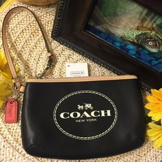 "Coach Horse & Carriage Wristlet, Medium Made with beautiful Saffiano leather. Interior lined with black sateen material and has one multifunction slot pocket. Outside zipper closure and tan/khaki leather strap with swivel style clip that can be attached to the inside of your handbag. Comes with red hang tag, care card and store price tags attached. Easily fits an iPhone 6plus!!! Appx dimensions: 7""(L) x 4.5""(H) x ""1(D) ***PRICE FIRM*** Coach Bags Clutches & Wristlets"