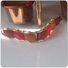 "VINTAGE LISNER THERMOSET/LUCITE BRACELET I love vintage Lisner & orange hues!  I have a few Lisner pieces in these colors and slowly letting go! This is a beautiful piece of Lisner in squares of burnt umber, caramel & red thermoset in a bamboo edged GP setting!  The colors are amazing!  I love this with a cream or tan color dress or white!  The bracelet measures 7.5"" including the clasp closed. A stunning piece of vintage Lisner inspired by nature!! Vintage Lisner Jewelry Bracelets"