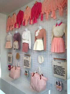 Visual Merchandising 101. Retail gridwall store display wall.  Women's clothing and accessories. Pink.