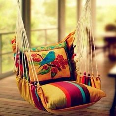 Adorable Bohemian Style Decor Idea :: I seriously love this chair, the colors, the pillow, everything!