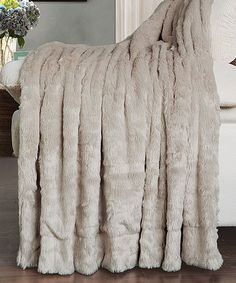 This Oatmeal Double-Sided Faux Fur Throw by BNF Home Inc. is perfect! #zulilyfinds