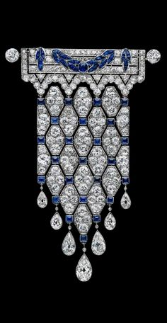 Boucheron - An early Art Deco platinum, diamond and sapphire brooch, French, circa 1910. #Boucheron #ArtDeco