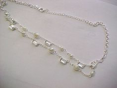 I'm auctioning 'crystal and pearl multi strand necklace' on #tophatter