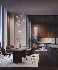 Irresistible penthouse interior at @karlatornet in Gothenburg, Sweden, featuring brown Beetle Chairs and the grandiose Moon Dining Table.  #gubi #gubiofficial #beetlechair #gamfratesi #moontable #spacecopenhagen