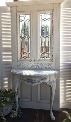 When a fifty year old door marries a fifty year old table Use as a stunning entry table or hall tree Both beveled and faceted glass send sunbeams dancing across the room. Refurbished Furniture, Repurposed Furniture, Furniture Makeover, Painted Furniture, Diy Furniture, Furniture Outlet, Door Hall Trees, Home Crafts, Diy Home Decor