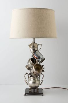 """Light & Sweet Base - Anthropologie.com (598) A gleaming collection of vintage tea service accoutrements from 1900 to 1960 lights up your parlor. No two are exactly alike. By Moss Studios.        * Steel, vintage silver pieces      * 150 watt max      * 96"""" cord      * 19""""H, 8"""" diameter"""