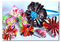 Flowers and hair bows made from bright colored candy wrappers.