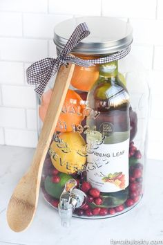 Fill a cute drink dispenser with all of the essentialsand festive ingredients like apples, cinnamon sticks, and bourbon. Get the tutorial atFantabulosity. What you'll need: Drink dispenser ($23; amazon.com); Wooden spoon ($6 for set of three; amazon.com)