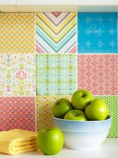 Embellish inexpensive 6x6-inch ceramic tiles with scrapbook paper for a custom backsplash.