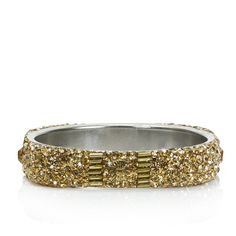 Set the trend when you step out in this squared off bangle from Saachi. It's completely covered in faceted gold beads, gold bugle beads and gold cz to ensure that you'll sparkle plenty. Wear it alone or have a celebration of all your fabulous bracelets climbing up your arm.