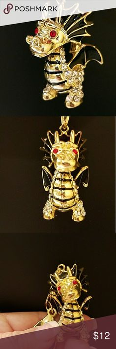 GAME OF THRONES Dragon Purse Charm Beautiful detail and an articulated head make this purse charm/key chain a great addition to any handbag. Gold tone with red gemstone eyes, black lacquered wings and head, rhinestone detail on body and tail.  Pic 5 shows light wear on hook. Accessories Key & Card Holders