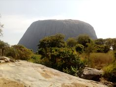 ZUMA ROCK An iconic landmark, featured on the 100 Naira bill, Zuma Rock stands at and is known as the gateway to Abuja. It is located in the Madalla region of Niger State and revered by some of the locals as a sacred rock. The Locals, Africa, Rock, Travel, Viajes, Skirt, Locks, Destinations, The Rock