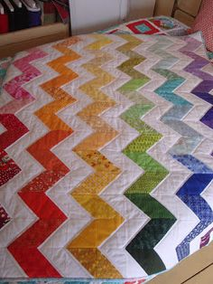 Would be fun to do a swap...like with Rebecca, Sandie, Wendy, Cheryl...we each take two colors.  Same white background fabric is a must.... Rainbow Zig Zag Quilt