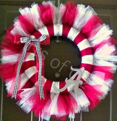 """Shout """"roll tide"""" with this handmade 12"""" University of Alabama wreath! Made with burgandy, white, and glitter silver tulle."""