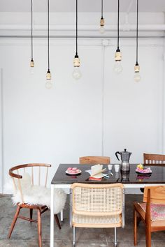 mismatched chairs around a rustic modern table with hanging exposed lights / sfgirlbybay Woven Dining Chairs, Mismatched Dining Chairs, Dining Room Chairs, Dining Furniture, Dining Rooms, Wooden Chairs, Modern Furniture, Kitchen Chairs, Dining Sets