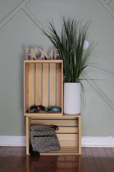 Create an easy do it yourself table for your entryway or living room. You only need a couple of wooden crates and some decorations like plants!