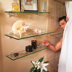 Most bathrooms have one space you can count on for additional storage, and that's over the toilet. And open glass shelves are a great storage place! #GlassShelvesRetail