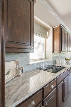 Fantasy Brown Granite With Ann Sacks Lucien Tile In Arabesque Azure