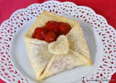 Cherry Pie Pastry is a small pastry that is shaped like an envelope and filled with cherry pie filling.