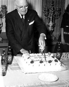 Former President Harry S. Truman cutting his 76th birthday party cake. The party was held at the Truman Library, May 8, 1960.