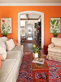 Even traditionally minded decor can benefit from a jolt of unexpected wall color. Here, a bright spice orange infuses a classic living room with energy. The color is used in small doses throughout the room so the wall color doesn't appear as an afterthought. The Color: Bryce Canyon -- Benjamin Moore/
