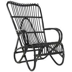 Furniture - Black Rattan Marlene Armchair - Hutsly. Lightweight, comfortable and stylish, this Rattan armchair is a bit of an icon! Widely used in the 60s, rattan is back and it hasn't aged! With its high back and curvy shape, the Marlene armchair is made in France and will look great in Scandi or Tropical-themed interiors.