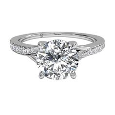 Modern bypass micropavé diamond band engagement ring by Ritani.