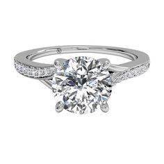 Modern bypass micropavé diamond band engagement ring by Ritani.