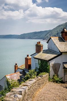 The quaint village of Clovelly, Devon, UK, sports amazing summer time views but the location brings a sting - the village is almost vertical, providing extraordinarily steep access to the cottages. Country Uk, Devon England, Beach Cottages, Coastal Style, Great Britain, Sun Lounger, Summer Time, Watercolour, Countries