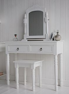 Side view of the New England white vanity table with antique brass handles, mirror and stool. Click here for larger images