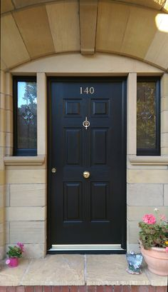 Small details make a big difference.  A stunning Colonial Ultimate Rockdoor in Onyx Black - fitted with an escutcheon, door knocker and central knob. #Rockdoor #CompositeDoor #HomeDecor
